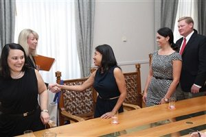 The author greeting the Deputy of the Gender Equality Sonja König after a discussion on gender equality legislation in Croatia.