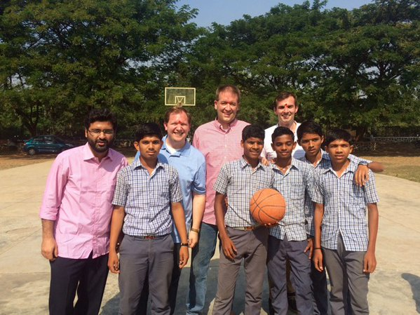 Delegates visiting small Indian village and playing a game of basketball