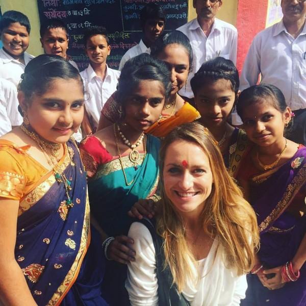Lynlie Wallace in Shivkar village with school girls